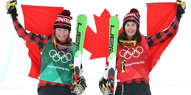 Kelsey Serwa, right, celebrates her gold medal win in women's skicross with silver medallist and teammate Brittany Phelan.