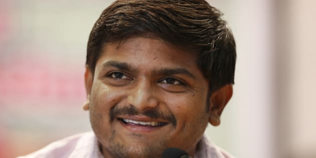 Hardik Patel smiles as he addresses the media after holding a meeting of his newly formed Patel Navnirman Sena (PNS) in New Delhi, India.