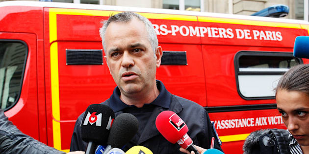 Fire chief Eric Moulin speaks to journalists near the scene in Paris