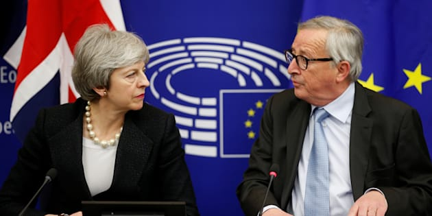 British Prime Minister Theresa May and European Commission President Jean-Claude Juncker look at each other during a news conference in Strasbourg, France March 11, 2019. REUTERS/Vincent Kessler