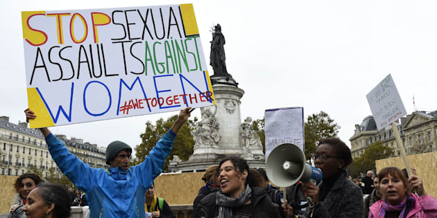 French activist Jean-Baptiste Redde, aka Voltuan, holds a placard as protesters take part in a gathering against gender-based and sexual violence in Paris on October 29, 2017.