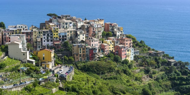 The colorful houses of Corniglia town, part of Cinque Terre, are crammed on a hill on the cost of the Mediterranean Sea.
