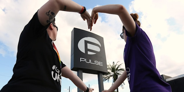 FILE PHOTO --  Heather Raleigh (L) and Paige Metelka make a heart shape as they pose during a photo shoot outside Pulse nightclub following the mass shooting last week in Orlando, Florida, U.S., June 21, 2016.  REUTERS/Carlo Allegri/File Photo