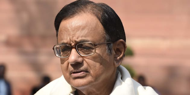 Homes of India's ex-finance minister, son searched in probe