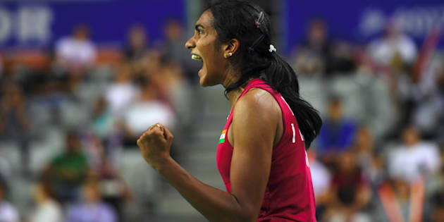 India's Pusarla V. Sindhu reacts to a point against Japan's Nozomi Okuhara during the women's singles final match at the Korea Open Badminton Superseries in Seoul on September 17, 2017. / AFP PHOTO / JUNG Yeon-Je