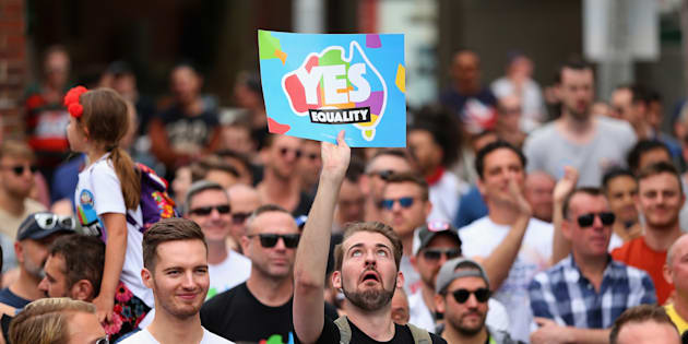 People display their support at a Marriage Equality rally in Sydney's Taylor Square