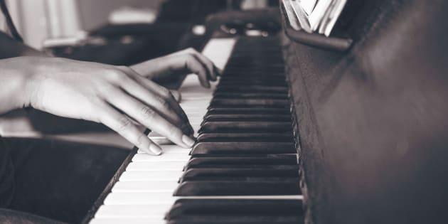 person playing upright piano in sephia photography  https://unsplash.com/photos/6JcFz_34qUM