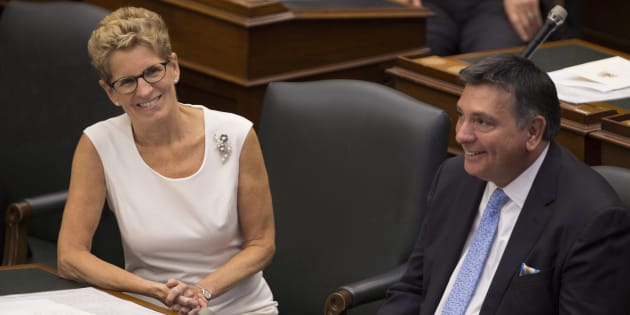 Ontario Premier Kathleen Wynne and Charles Sousa, smile following the speech from the throne in Toronto on Sept. 12, 2016.