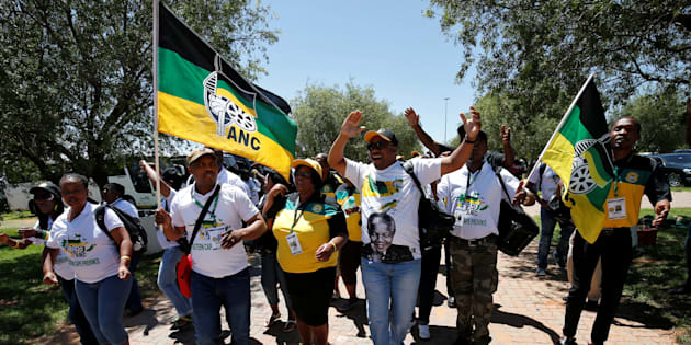 Delegates chant slogans as they arrive for the 54th National Conference of the ruling African National Congress (ANC) at the Nasrec Expo Centre in Johannesburg, South Africa December 16, 2017.