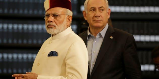 Indian Prime Minister Narendra Modi accompanied by Israeli Prime Minister Benjamin Netanyahu (R) during a visit to Yad Vashem Holocaust memorial in Jerusalem July 4, 2017.