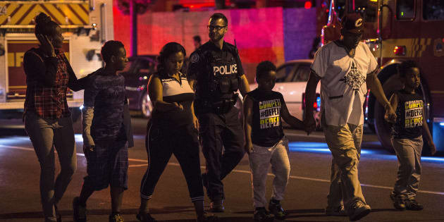 Police escort civilians away from the scene of a mass casualty incident in Toronto on Sunday, July 22, 2018.