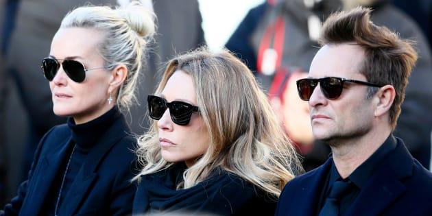 Depuis la mort de Johnny Hallyday, son épouse Laeticia et ses deux premiers enfants, David et Laura, ici photographiés lors des obsèques du chanteur, s'affrontent sur l'héritage du rockeur.