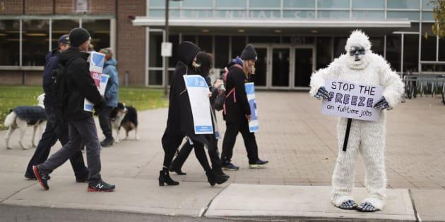 An instructor is dressed up as a Yeti while she walks the picket line at the East York Centennial College campus during the third week of the Ontario community college strike.