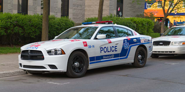A closeup to a parked police car in Montreal during the day.