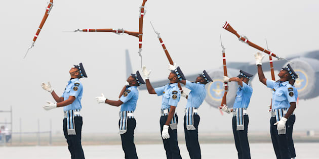 Indian Air Force soldiers toss their rifles as they perform during the full-dress rehearsal for Indian Air Force Day.