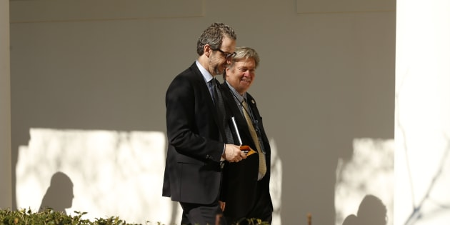 Gerald Butts, adviser to Prime Minister Justin Trudeau, walks down the West Wing colonnade with Trump  chief strategist Bannon at the White House on Feb. 13, 2017.