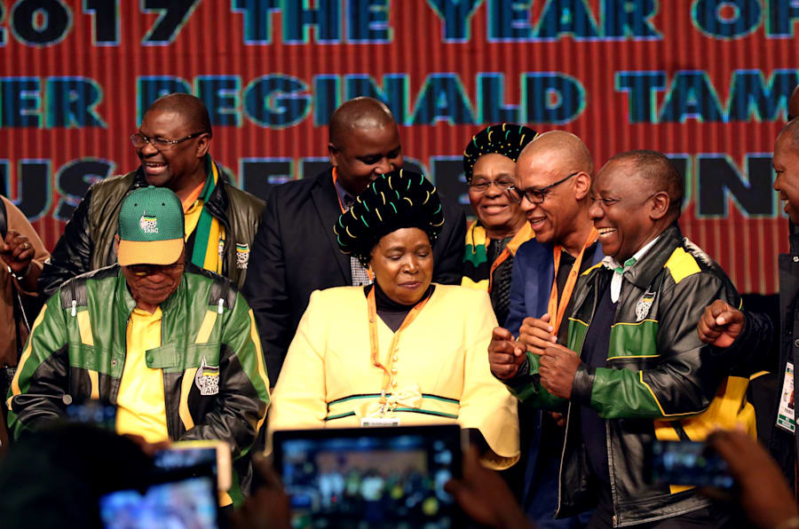 President Jacob Zuma dances with former AU Commission chairperson Nkosazana Dlamini-Zuma and South Africa's Deputy President Cyril Ramaphosa.