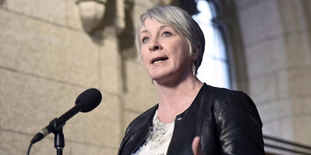 Minister of Employment, Workforce Development and Labour Patty Hajdu speaks to reporters during a weekend meeting of the national caucus on Parliament Hill in Ottawa on March 25, 2017.