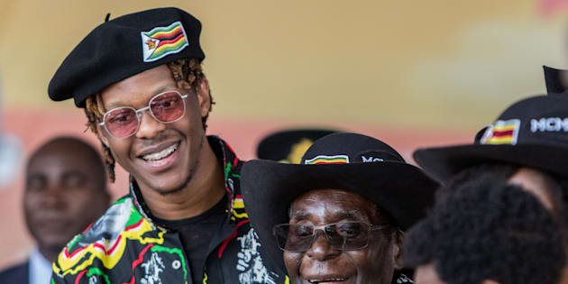 Zimbabwean President Robert Mugabe (C), with his son Robert Jr, smiles at his grandson during his 93rd birthday celebrations hosted at Rhodes Preparatory School in Matopos, Matabeleland South Province, on February 25, 2017.