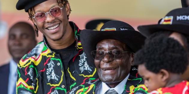 Zimbabwean President Robert Mugabe (C), with his son Robert Jr.