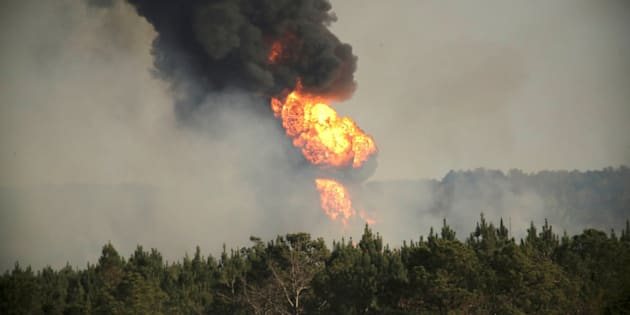 Flames shoot into the sky from a gas line explosion in western Shelby County, Alabama, on Monday.