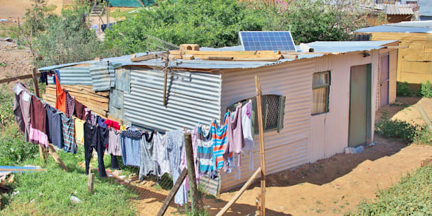 Solar panels on the roof of shack in informal settlement Enkanini, on the outskirts of Stellenbosch in Western Cape.