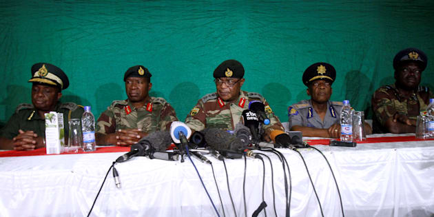 Commander of Zimbabwe Defence Forces General Costantino Chiwenga (C) addresses the media with other security chiefs in Harare, Zimbabwe November 20, 2017.
