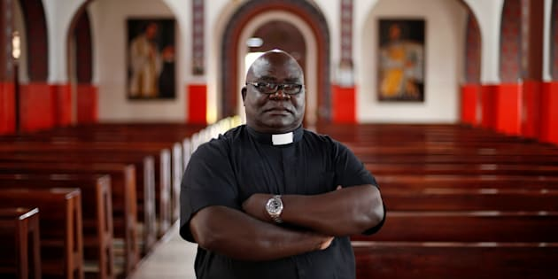 Father Fidelis Mukonori, a Jesuit priest who is Mugabe's close friend poses for a photograph after an interview with Reuters at Chishawasha mission primary school near Harare, Zimbabwe, November 26, 2017.