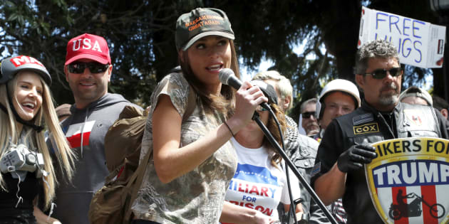 Faith Goldy, centre, a Canadian right-wing social and political commentator speaks to supporters of U.S. President Donald J. Trump as Lauren Southern, left, a Canadian conservative and libertarian activist listens at an event at the Martin Luther King Jr. Civic Center Park in Berkeley, Calif., 27 April 2017.