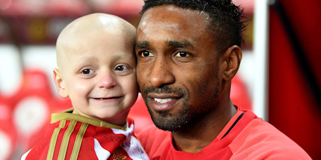 Bradley Lowrey (L) and Jermain Defoe of Sunderland (R) pre-match during the Premier League match between Sunderland and Chelsea at Stadium of Light on December 14, 2016 in Sunderland, England.