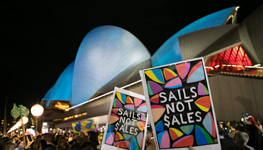 Torchlight Protest At Racing Ad On Sydney Opera