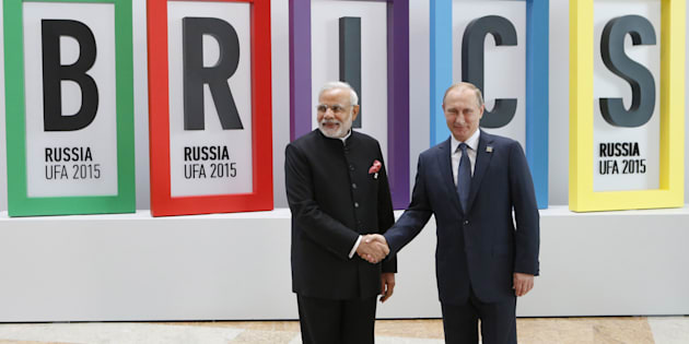 Russian President Vladimir Putin (R) greets Indian Prime Minister Narendra Modi during the welcoming ceremony at the BRICS Summit in Ufa, Russia, July 9, 2015.