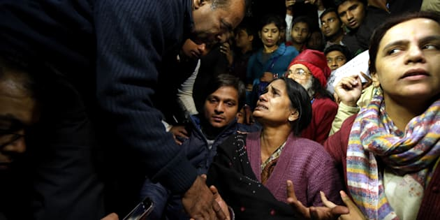 Father of Nirbhaya consoles her mother as she broke down during protest against the release of juvenile convict of the 16 December Gang-rape, along with student activists at Jantar Mantar on December 20, 2015 in New Delhi.
