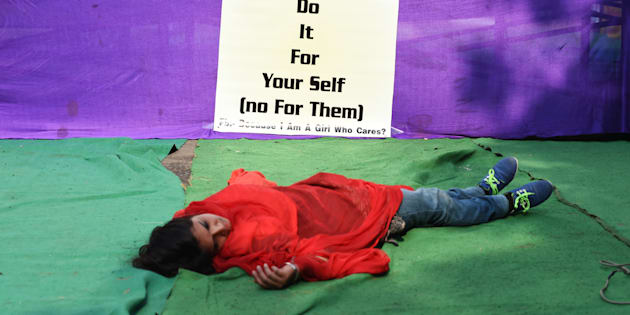 An Indian activist  participates in a street play to create awareness on violence against women in New Delhi on December 16, 2014, the second second anniversary of the fatal gang-rape of a student in the Indian capital that unleashed a wave of public anger over levels of violence against women in the country. Women's safety in India has not improved since the fatal gang-rape of a student in New Delhi, the victim's parents said December 16 on the anniversary of the attack that sparked international outrage. AFP PHOTO / SAJJAD HUSSAIN        (Photo credit should read SAJJAD HUSSAIN/AFP/Getty Images)