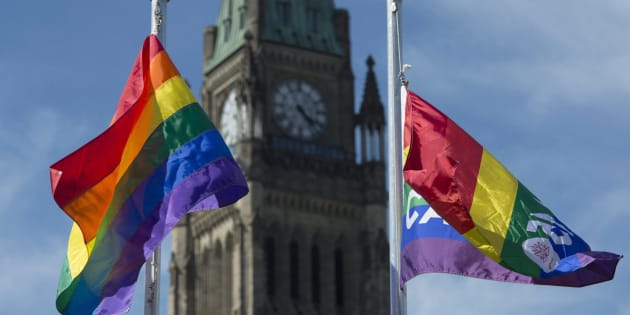 The pride flags fly on Parliament Hill following a ceremony with Prime Minister Justin Trudeau on June 14, 2017.