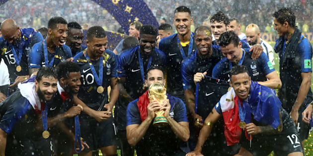 France's Adil Rami (centre) and his team-mates celebrate after the FIFA World Cup 2018 final at the Luzhniki Stadium in Moscow, 15th July 2018