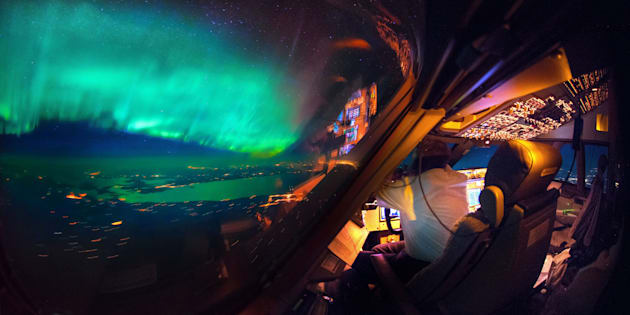 PIC BY CHRISTIAAN  VAN HEIJST AND DAANS KRANS/CATERS NEWS - (PICTURED: An amazing view of the Northern Lights from the cockpit. ) - This is truly heavenly weather  as pictures taken from an airplane cockpit reveal what pilots see from above. It looks like at cruising altitude the weather really hots up, with the flight deck revealing some amazing scenes. Thunderstorms light up the insides of clouds, lightening streaks across the sky like cracks in a windscreen, the northern lights sweep uninterrupted across the sky and the galaxy stretches on forever. The pictures were captured by senior first officer Christiaan van Heijst, a 33-year-old from the Netherlands, and his friend Daan Krans. SEE CATERS COPY.