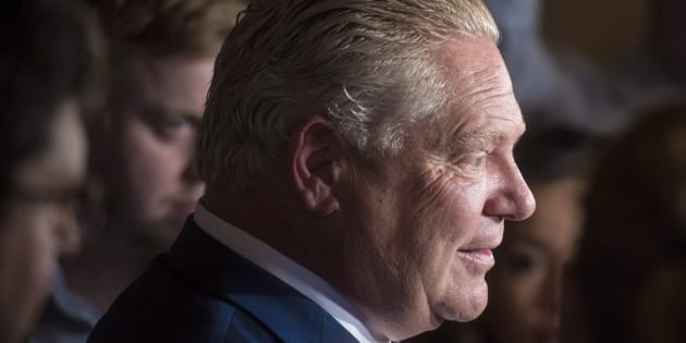 Ontario premier-designate Doug Ford, seen speaking to reporters on June 19, 2018, didn't participate in Toronto's Pride Parade.