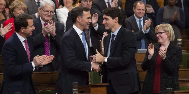 Prime Minister Justin Trudeau shakes hands with the Finance Minister Bill Morneau following the fiscal economic update in the House of Commons on Nov. 21, 2018.