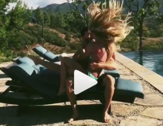 Britney Spears, boyfriend smooch by pool