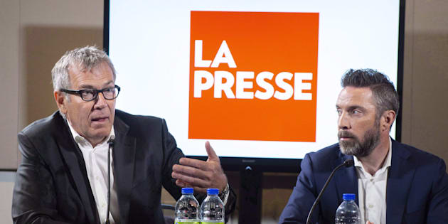 La Presse publisher Guy Crevier, left, responds to a question as president Pierre-Elliott Levasseur looks on during a news conference Tuesday, May 8, 2018 in Montreal.
