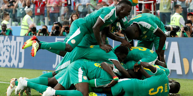 Soccer Football - World Cup - Group H - Poland vs Senegal - Spartak Stadium, Moscow, Russia - June 19, 2018. Senegal's M'Baye Niang celebrates scoring their second goal with teammates.