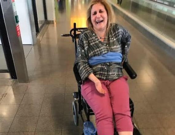Delta passenger with MS tied to chair with blanket