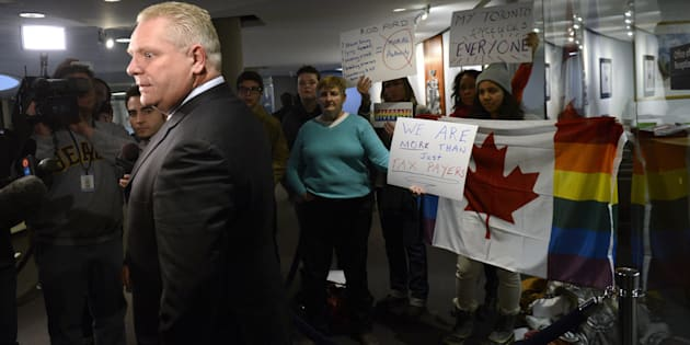 Doug Ford takes questions from the media outside his brother Toronto Mayor Rob Ford's office at Toronto city hall on Feb. 11 2014.