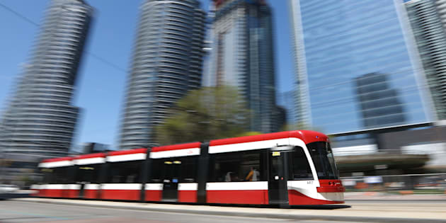 A TTC streetcar moves along Queens Quay.