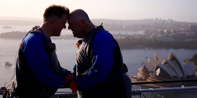 Warren Orlandi and Pauly Phillips react after they became the first same-sex couple to marry atop of the Sydney Harbour Bridge, just two days out from the 40th anniversary of the Sydney Gay and Lesbian Mardi Gras, in Australia, March 1, 2018.
