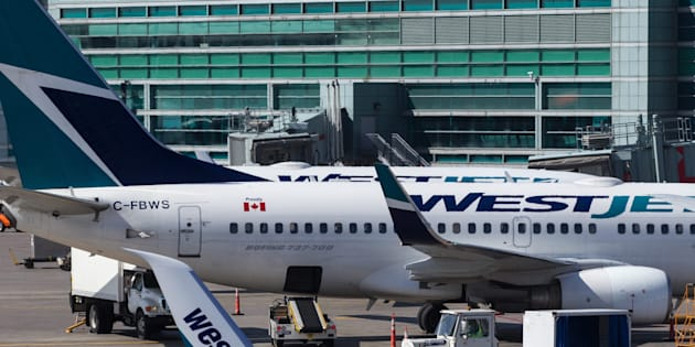 Westjet planes on the tarmac at Toronto Pearson airport in Toronto, Ont., on May 7, 2015. THE CANADIAN PRESS IMAGES/Lars Hagberg