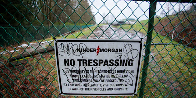 A 'No Trespassing' sign is displayed on a fence outside of the Kinder Morgan Inc. facility in Burnaby, British Columbia, Canada, on Wednesday, April 11, 2018.