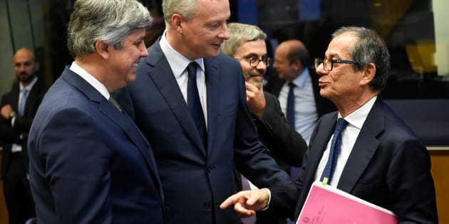 Portuguese Finance Minister and president of Eurogroup Mario Centeno (L) and French Economy, Finance Trade Minister Bruno Le Maire (C) talk with Italian Minister of Economy and Finance Giovanni Tria during an Eurogroup meeting at the EU headquarters in Luxembourg on October 1, 2018. (Photo by JOHN THYS / AFP)        (Photo credit should read JOHN THYS/AFP/Getty Images)
