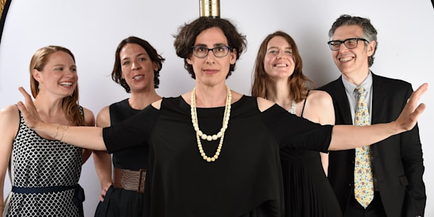 NEW YORK, NY - MAY 31:  Journalist Sarah Koenig (center)  poses with her award with Ira Glass (R) and guests and at The 74th Annual Peabody Awards Ceremony at Cipriani Wall Street on May 31, 2015 in New York City.  (Photo by Mike Coppola/Getty Images for Peabody Awards)